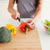 Young female cooking vegetables while standing in the kitchen stock photo © wavebreak_media