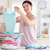 Smiling Woman folding clothes in a utility room stock photo © wavebreak_media