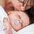 Brunette woman kissing the head of her baby indoors stock photo © wavebreak_media