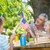 happy family having picnic and holding american flag stock photo © wavebreak_media