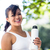 portrait of smiling athletic woman holding water bottle and look stock photo © wavebreak_media