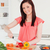 Beautiful young red-haired woman cutting some carrots in the kitchen in her appartment stock photo © wavebreak_media