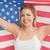 uśmiechnięta · kobieta · amerykańską · flagę · studio · banderą · czerwony · kobiet - zdjęcia stock © wavebreak_media