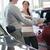 Salesman showing documents ta a woman in a car shop stock photo © wavebreak_media