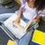 kobieta · za · pomocą · laptopa · biblioteki · kubek · stolik - zdjęcia stock © wavebreak_media