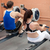 Sportsmen using a rower in a fitness center stock photo © wavebreak_media