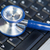 Blue angled stethoscope on keyboard on a blue background stock photo © wavebreak_media