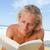 grave · hombre · toalla · de · playa · lectura · libro · jóvenes - foto stock © wavebreak_media