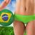 composite image of fit girl in green bikini holding brazil footb stock photo © wavebreak_media