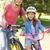 famiglia · biciclette · padre · estate · parco - foto d'archivio © wavebreak_media