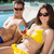smiling couple with drinks sitting by swimming pool stock photo © wavebreak_media