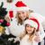 festive mother and daughter decorating christmas tree stock photo © wavebreak_media