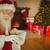 smiling santa claus holding a scroll stock photo © wavebreak_media
