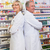 pharmacist with his colleague standing with arms crossed stock photo © wavebreak_media