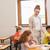 поощрение · довольно · учитель · помогают · классе - Сток-фото © wavebreak_media