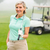 Happy golfer with golf buggy behind  stock photo © wavebreak_media