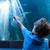 fiatalember · mutat · fény · tank · akvárium · hal - stock fotó © wavebreak_media