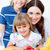 Jolly mother and her children eating waffles with strawberries stock photo © wavebreak_media