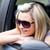 encantador · feminino · motorista · óculos · de · sol · carro - foto stock © wavebreak_media