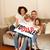 Happy family sitting on a sofa stock photo © wavebreak_media