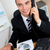Charming businessman using phone in office stock photo © wavebreak_media