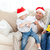 father and son playing with a cracker on the sofa stock photo © wavebreak_media