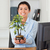 Beautiful woman holding a plant while looking at the camera at the office stock photo © wavebreak_media
