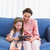mother and daughter using tablet on couch stock photo © wavebreak_media