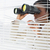 Businesswoman peeking with binoculars through blinds stock photo © wavebreak_media