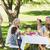 familie · vakantie · barbecue · vrouw · huis · voedsel - stockfoto © wavebreak_media
