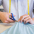 Student cutting fabric with pair of scissors  stock photo © wavebreak_media