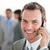 glimlachend · zakenman · naar · telefoon · witte · technologie - stockfoto © wavebreak_media