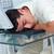 Tired businessman sleeping at his desk stock photo © wavebreak_media