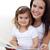 retrato · madre · hija · lectura · libro · salón - foto stock © wavebreak_media