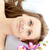 Beautiful woman lying on a massage table with flowers in a spa center stock photo © wavebreak_media