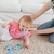 lovely woman and her baby playing with puzzle pieces while sitting on a carpet in the living room stock photo © wavebreak_media