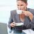 Portrait of a young businesswoman drinking tea in her office stock photo © wavebreak_media