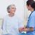 Nurse comforting a patient in hospital ward stock photo © wavebreak_media