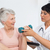 physiotherapist assisting senior woman to lift dumbbell stock photo © wavebreak_media