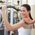 fit brunette using weights machine for arms with trainer touchin stock photo © wavebreak_media