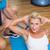 nő · sportruha · nyújtás · fiatalember · néz · fitnessz - stock fotó © wavebreak_media