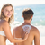 pretty blonde putting sun tan lotion on her boyfriend stock photo © wavebreak_media