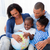 glückliche · Familie · halten · Welt · Sofa · Frau · Familie - stock foto © wavebreak_media