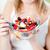 mulher · salada · de · frutas · tigela · verde - foto stock © wavebreak_media