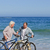 retired couple with their bikes on the beach stock photo © wavebreak_media