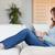 młoda · kobieta · posiedzenia · kanapie · pracy · laptop · komputera - zdjęcia stock © wavebreak_media