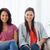zwei · Frauen · Lächeln · Sitzung · Couch · zusammen · aussehen - stock foto © wavebreak_media