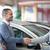 Smiling salesman shaking a customer hand in a car shop stock photo © wavebreak_media