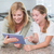happy mother and daughter using tablet pc together stock photo © wavebreak_media