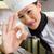 smiling female cook gesturing okay sign in kitchen stock photo © wavebreak_media